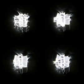 Four versions of a floodlight through rain on a window.jpg