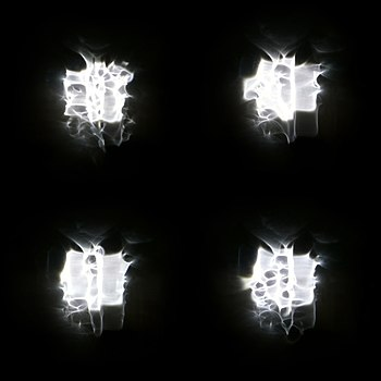 Four versions of a floodlight through rain on a window