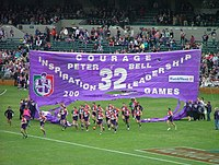Before the start of each AFL games, players run through a banner constructed by supporters.