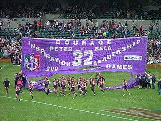 Banner (Australian rules football) - Fremantle players enter Subiaco Oval, by running through a celebratory banner before a game in 2004
