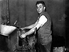 2d49d6aa427 A man working in hat manufacture with no protective equipment
