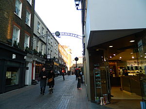 Ganton Street - The corner of Carnaby Street and Ganton Street, looking east, showing typical shop and upper floor fronts for the area.