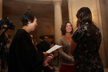 A same-sex marriage solemnized in San Francisco City Hall on June 28, 2013, just hours after the Ninth Circuit stay was lifted. Gay Marriages at SF City Hall.jpg