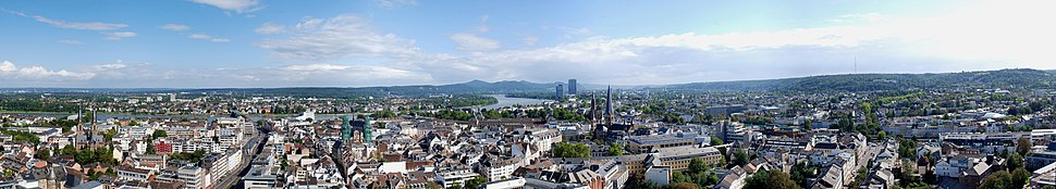View over central Bonn as seen from the Stadthaus, including the Siebengebirge,  a hill range on the east bank of the Middle Rhine.