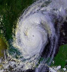 Satellite image of a tropical cyclone in the Western Gulf of Mexico. It covers a large area and has an eye at center.
