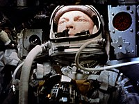 Close-up of John Glenn in space helmet during his flight, 1962