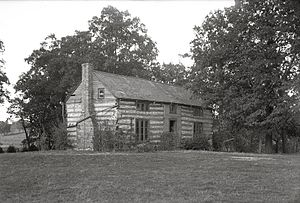 Grant's Farm - Horizontal, black and white photograph of three-quarter view of Grant's log cabin and surrounding grounds.