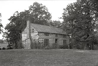 Grant's Farm - Horizontal, black and white photograph of three-quarter view of Grant's log cabin and surrounding grounds in 1912