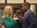 Heather Fitzenhagen and Byron Donalds confer on the House floor.jpg