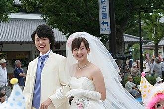 Strapless dress - Japanese bride wearing a strapless dress, 2010
