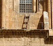The immovable ladder. Detail from photograph of main entrance above, taken in 2005.