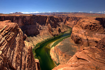 The Colorado was named for the reddish color caused by its natural sediment loads, but damming the river has caused it to acquire a clear green hue as seen here in lower Glen Canyon. Horseshoebend smt.jpg