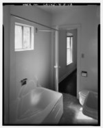 INTERIOR OF BATHROOM SHOWING DOOR TO SOUTH BEDROOM AND ALUMINUM-FRAMED SLIDING GLASS WINDOW ABOVE BATHTUB AT PHOTO LEFT. VIEW TO SOUTHEAST. - Bishop Creek Hydroelectric System HAER CAL,14-BISH.V,5D-18.tif