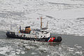 Ice-breaking tug creates track for Algoeast 130210-G-ZZ999-005.jpg