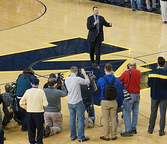 Jim Harbaugh - Harbaugh introduced as the head football coach at Michigan during half-time of a men's basketball game