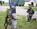 Indian Army soldiers find a handgun while searching a roleplaying insurgent leader during a field training exercise with the U.S. Army in 2013.jpg