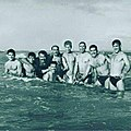 Iran Champion Wrestlers in 1954. From left Nasser GivehChi, MohammadAli Fardin, Abbas Izad Panah, Qolamreza takhti, Sho'ae Motamedi, Qolamreza Majid, Mahmood MollaQasemi, Mehdi Yaghoobi, Front Mohamood Monsefi (Reporter).jpg