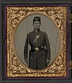Isaac Yost of Company C, 118th Regiment Illinois Infantry, standing in uniform with bayoneted musket and revolver LOC 5228554367.jpg