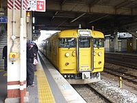 JNR 115 Setouchi yellow livery D-01 set at Kurashiki Station.jpg