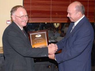 Faisal Al-Fayez - Faisal al-Fayez (r) awarding Arab Medical Association Against Cancer (AMAAC) award to Dr. Joe Harford of the National Cancer Institute in 2007