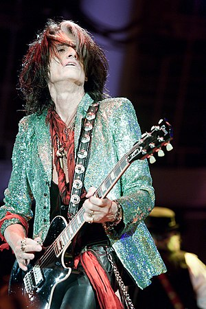 Joe Perry (musician) - Perry performing with Aerosmith in April 2013.