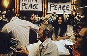 John Lennon performing Give Peace a Chance 1969.jpg