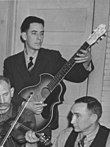 Kay Kraft Venetian guitar played by Fields Ward of The Bog Trotters Band, in Galax, Vieginia in 1937 (clip).jpg