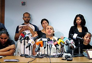 Khaled Ali - Khaled Ali with some of the families of the victims of Maspero massacre.