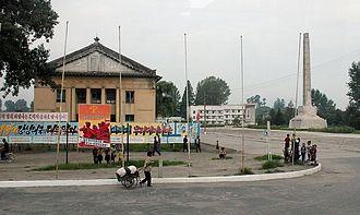 Kowon County - Propaganda murals at the Kowon-ŭp, North Korea.