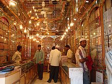 Several men inside a traditional bangle shop in the market.