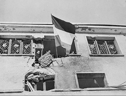 Civilians in Wiltz flying the flag of Luxembourg during the town's liberation by U.S. forces Liberation of Wiltz in Luxembourg.jpg