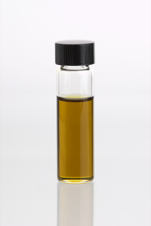 English: Glass vial containing Lime Essential Oil
