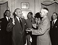 Louis Johnson swears in Omar Bradley as the first Chairman of the Joint Chiefs of Staff.jpg
