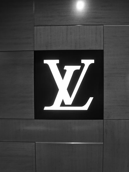 "Louis Vuitton's ""LV"" logo Louis Vuitton or shortened to LV, is a French fashion house founded in 1854 by Louis Vuitton Photography by david adam kess, madrid 2016.jpg"