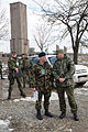 Lt Col Mick Dolan discussing the exericse with his finnish counterpart with the Serb monument in Background (4425041620).jpg