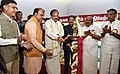 M. Venkaiah Naidu lighting the lamp at the inauguration of a Photo Exhibition on 'New India – Resolve to Make', organised by the Ministry of Parliamentary Affairs and DAVP.jpg