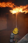 "MCBJ firefighters take on Kadena's ""burn house"" DVIDS35218.jpg"