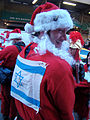 Man in Santa suit with Magen David on back (New York Santacon 2008).jpg