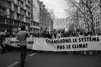 "2018 United Nations Climate Change Conference - ""Change the system, not the climate"" at the People's Climate March in Paris, on 8 December 2018."