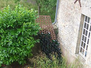 Marston Mat - Marston Mat repurposed for storage of empty wine bottles on a farm in Normandy in 2007. Hooks and slots along long edges clearly visible