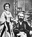 Marx's daughter Jenny Longuet standing and Karl Marx seated - photograph.jpg