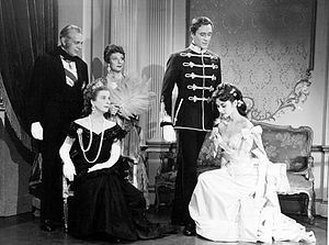 Mayerling (1957 film) - Raymond Massey, Diana Wynyard (seated), Judith Evelyn, Mel Ferrer and Audrey Hepburn in Mayerling (TV episode of Producers' Showcase, 1957)