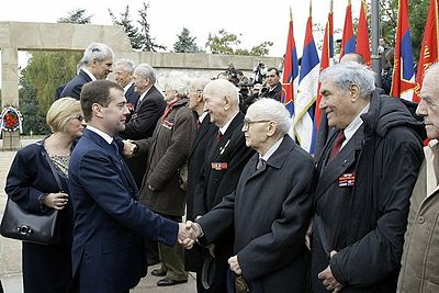 Boris Tadic and Dmitry Medvedev during celebrations for 65th anniversary Medvedev and Tadic with veterans 20 Oct 2009.jpg