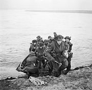 Men of the 15th (Scottish) Division use a small assault craft to cross the Rhine near Xanten, 24 MArch 1945. BU2154