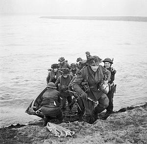 Kent Fortress Royal Engineers - Men of 15th Scottish Division crossing the Rhine by stormboat on 24 March 1945.