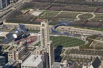 Millennium Park - Pritzker Pavilion and BP Bridge in Millennium Park, with Daley Bicentennial Plaza behind, seen from Willis Tower in 2007