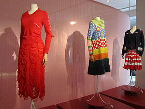 ModeMuseum Provincie Antwerpen - Knitwear exhibition ONTRAFEL. Tricot in de Mode at the Fashion Museum (ModeMuseum, MOMU) in. The central design is a dress by Walter Van Beirendonck, inspired by the colourful clothing of the Hui'an women of Quanzhou, China. The flanking designs are by the German-born fashion designer Bernhard Wilhelm. On the left a jersey sweater with elbows like the heels of a sock, and a skirt with alternating strips of knitted wool and loose threads. On the right the Beefeater wool jacket and Superflyskirt jersey dress.
