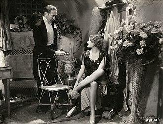 Morocco (film) - L to R: La Bessière (Adolphe Menjou), Amy Jolly (Marlene Dietrich)