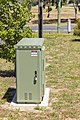 NBN FTTN cabinet, manufactured by CommScope, with pillar located in Junee.jpg