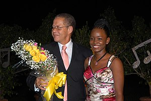 Jamaican Prime Minister Bruce Golding presents Nadjé Leslie with flowers at her debut album launch at the Terra Nova Hotel (2007)